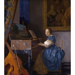 A Young Woman Seated at a...