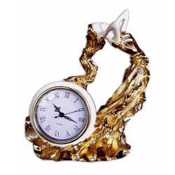 Clock with sculpture...